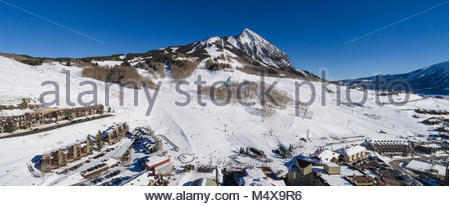 Crested Butte Mountain and the ski area base on a perfect winter afternoon. - Stock Photo