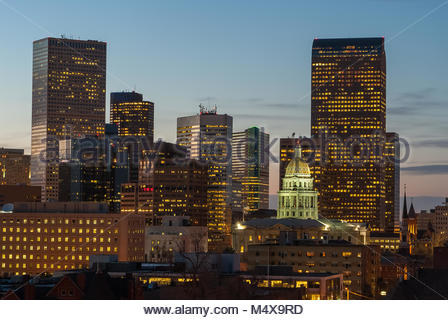 The Capitol dome stands in stark contrast to the towering buildings of downtown Denver, Colorado. - Stock Photo