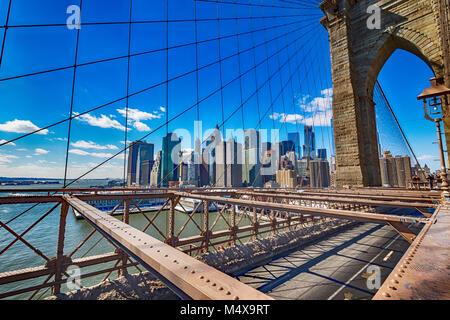 The Brooklyn Bridge and the skyline of Manhattan. - Stock Photo