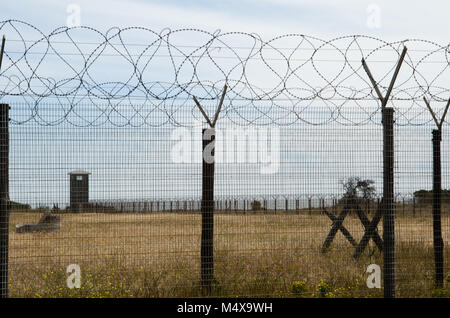 Barbed wire fence at Robben Island near Cape Town - Stock Photo
