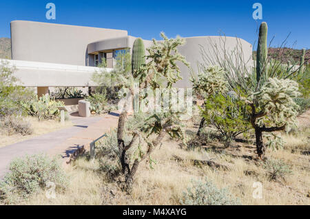 This is a very attractive visitor center with spectacular views of mountains and Saguaros right from its back porch. - Stock Photo