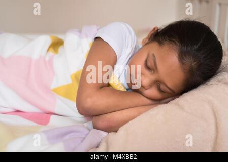 young little asian girl sleeping lying on bed in her bedroom. sleep concept - Stock Photo