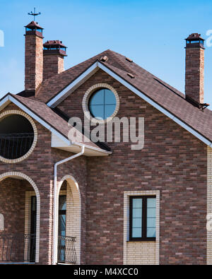 house with a gable roof window - Stock Photo