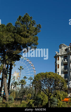 Ferris wheel in the city of Nice, french riviera, against a deep blue sky. (Winter time) - Stock Photo