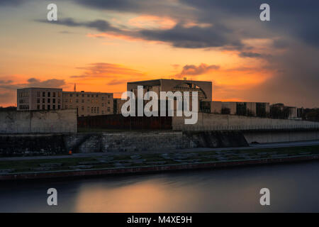 Swiss embassy and German chancellery, as sunset breaks a storm. - Stock Photo