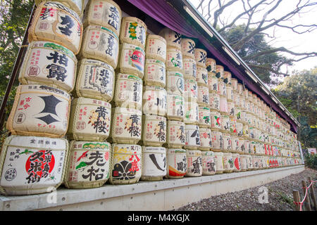 Sake barrels at the entrance to the Meiji Jingu shrine in Tokyo , Shibuya, Tokyo 151-8557, Japan - Stock Photo