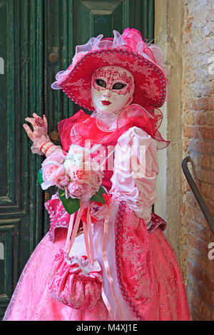 A lady dressed like a female cat during the Carnival of Venice (Carnevale di Venezia) in Venice, Italy - Stock Photo