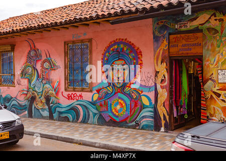 Bogotá, Colombia - Section of Street Art mural painted on the exterior streetside wall of a building, by the well - Stock Photo