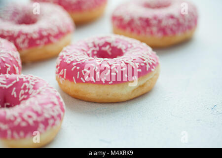 Donut. Sweet icing sugar food. Dessert colorful snack. Glazed sprinkles. Treat from delicious pastry breakfast. - Stock Photo