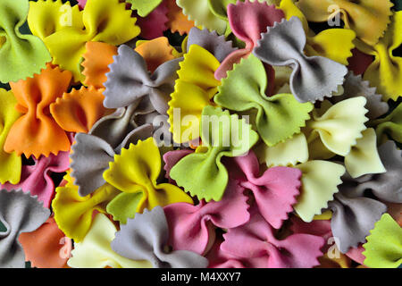 Dried colorful italian pasta farfalle or bows background - Stock Photo