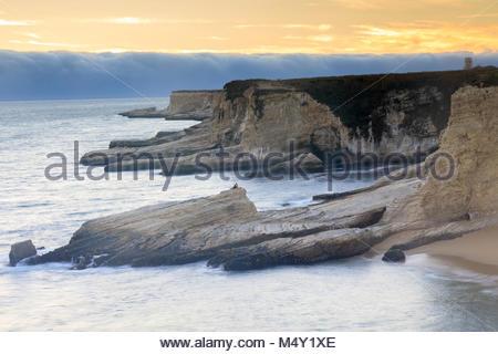 Foggy Sunset Coastline. - Stock Photo