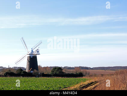 A view of Burnham Overy Staithe tower windmill in farmland by the A149 coast road in North Norfolk, England, United - Stock Photo