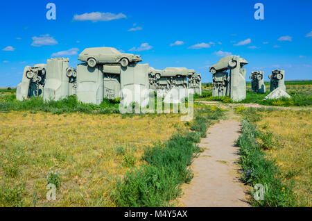 Outdoor sculpture of painted gray cars, arranged to look like Stonehenge, in a Nebraska field. This is a popular - Stock Photo