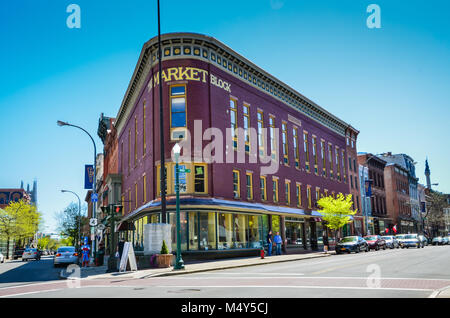 Shops and brown stone buildings in the city of Troy in Upstate New York. - Stock Photo