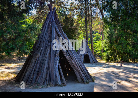 Bark structure exhibit at Marshall Gold Discovery State Historic Park in Coloma, California depicts daily life at - Stock Photo