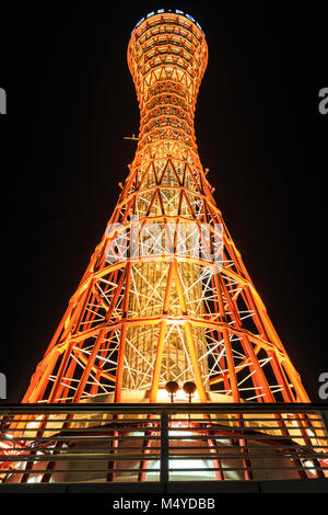 Japan, Kobe. Night time view of the illuminated orange coloured Kobe Port Tower against black sky. - Stock Photo