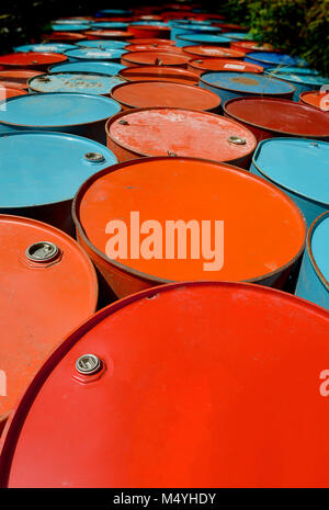 colorful of old oil tanks after uesd at outdoor junk place photo in sun lighting. - Stock Photo