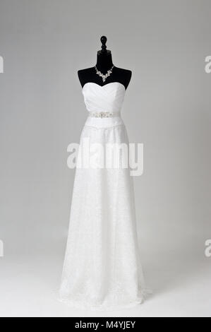 Modern white wedding dress isolated on Grey background - Stock Photo