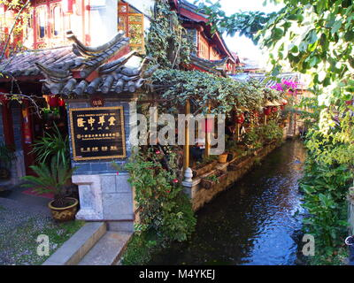 Lijiang Old Town with a clear water valley. Travel in Lijian in Yunnan Province, China in 2012, November 17th. - Stock Photo