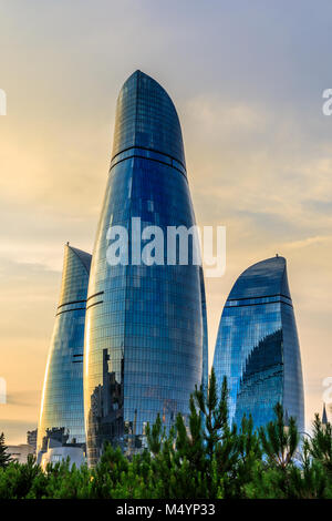 Three flame towers skyscrapers on the sunset in the city center, Baku, Azerbaijan - Stock Photo