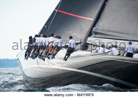The crew of Svea on the rail as they sail upwind in the J Class World Championship hosted in Newport, August 2017. - Stock Photo
