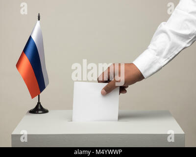 Ballot box with national flag of Russia. Presidential election in 2018. hand throwing a ballot - Stock Photo