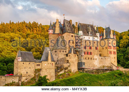 Burg Eltz castle in Rhineland-Palatinate at sunset - Stock Photo