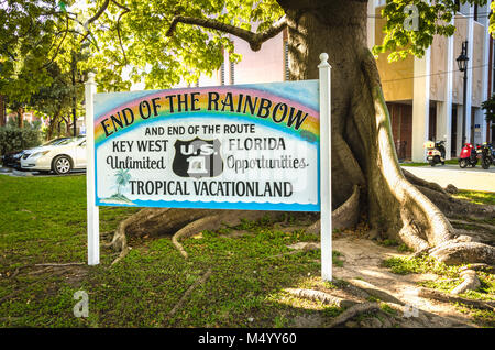 End of the Rainbow sign next to Kapok tree and end of U.S. Route 1. US 1 travels along the east coast of Florida, - Stock Photo