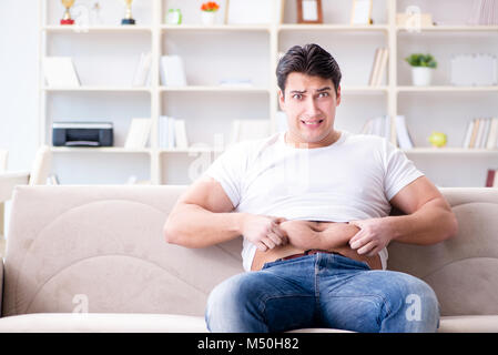 Man suffering from extra weight in diet concept - Stock Photo