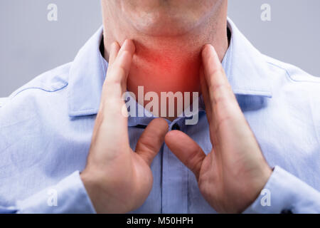 Close-up View Of A Man With Pain On His Neck Over The White Background - Stock Photo