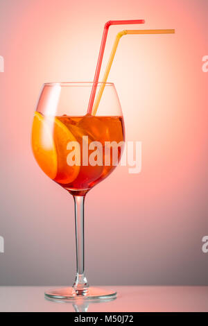Trendy popular Italian drink Summer refreshing faintly alcoholic cocktail Aperol spritz in a glass with ice decorated - Stock Photo