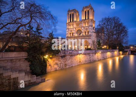 Notre Dame de Paris Catheral at dusk with the overflowing Seine River, 4th Arrondissement, Paris, France - Stock Photo
