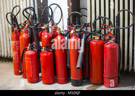 Many red fire extinguishers - Stock Photo