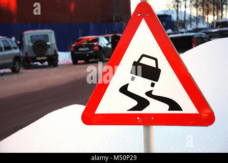varning sign for slippery road ahead - Stock Photo