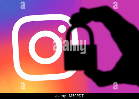 LONDON, UK - FEBRUARY 5th 2018: Instagram security concept. Silhouette of a hand holding a padlock infront of the - Stock Photo