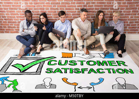 Group Of People Looking At Customer Satisfaction Survey Concept - Stock Photo