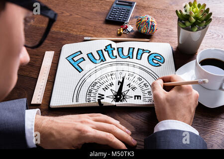 Man Drawing Future And Compass Guidance Concept - Stock Photo