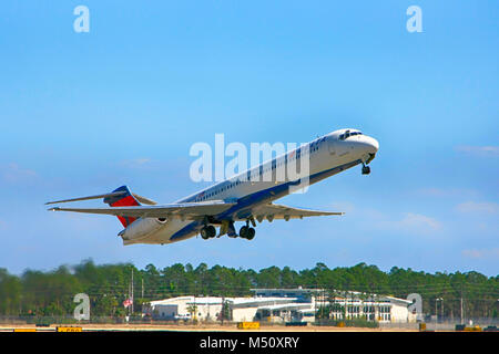 Delta Airlines MD-88 departing from Fort Myers International Airport in Florida USA - Stock Photo