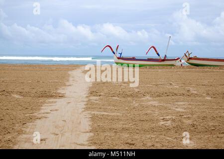 Traditional balinese jukung fishing boats on Nuca Dua beach - Stock Photo