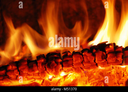 live coals in the oven - Stock Photo