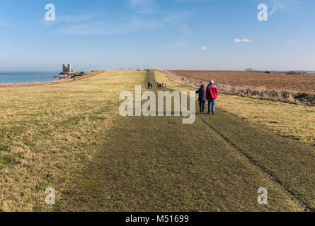 Pathway along the grass covered coastal clifftops of Reuclver country park near to Reculver Towers, in Kent, UK - Stock Photo
