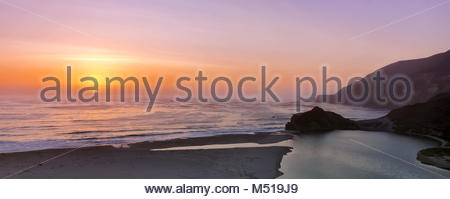 Sunset over Little Sur River mouth. - Stock Photo
