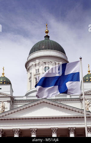 fluttering national flag of Finland against Helsinki Cathedral - Stock Photo