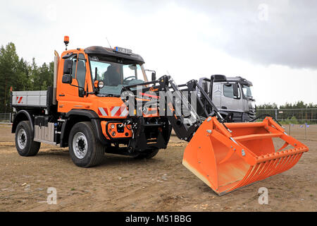 Mercedes-Benz Unimog U423 multi-purpose truck and Hauer RX-500 front loader on Maxpo 2017. - Stock Photo