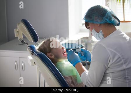 Little child in stomatology chair - children dentistry - Stock Photo