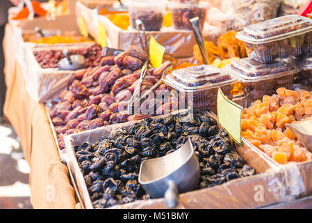 Close up assorted dried fruits and berries on market place in Tel Aviv, Israel. Selective focus, space for text - Stock Photo