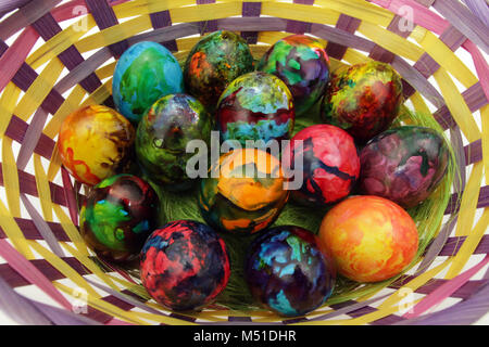 Easter eggs. Handmade painted eggs in basket for Easter celebration isolated on white background. Easter. Colored - Stock Photo