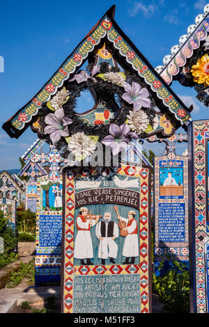 Carved wooden panel with epitaph at cross on grave, Merry Cemetery (Cimitirul Vesel) in Sapanta, Maramures Region, - Stock Photo