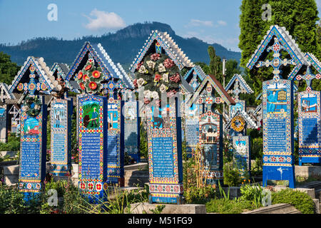 Carved wooden panels with epitaphs at crosses on graves, Merry Cemetery (Cimitirul Vesel) in Sapanta, Maramures - Stock Photo