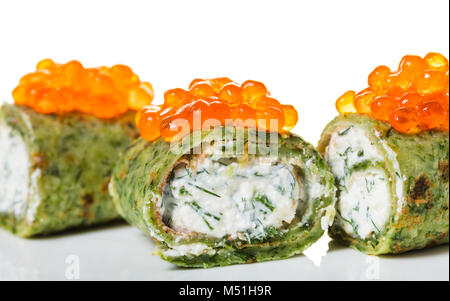 pancakes with spinach and red caviar on white background - Stock Photo